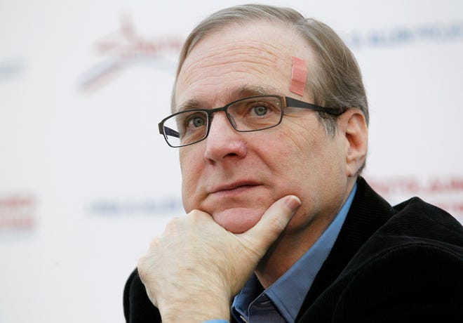 FILE - In this Dec. 13, 2011, file photo, Microsoft co-founder Paul Allen pauses at a news conference in Seattle. Allen made his largest-ever foray into congressional politics this year by donating $100,000 to a group seeking to keep Republicans in control of the U.S. House of Representatives. (AP Photo/Elaine Thompson, File)