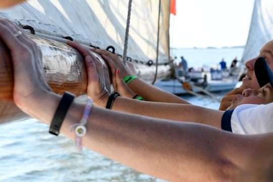 The Kathryn crew holds the main sail steady during the 59th annual Deal Island Skipjack Race on Monday, Sept. 3.