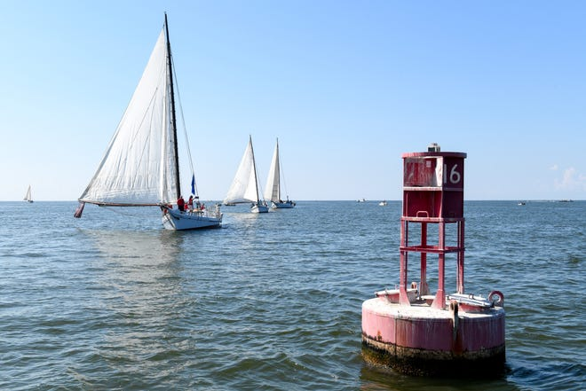 Boats sail past the first turn on the Chesapeake Bay during the 59th annual Deal Island Skipjack Race on Monday, Sept. 3.