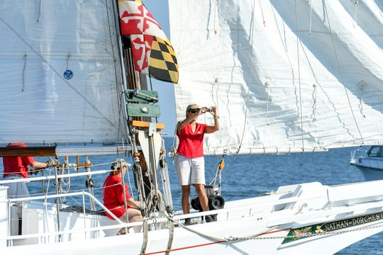 Boats line up in the Chesapeake bay for the 59th annual Deal Island Skipjack Race on Monday, Sept. 3.