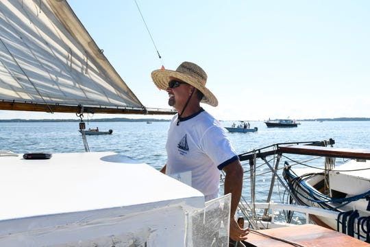 Capt. David Whitelock steers the Kathryn during the 59th annual Deal Island Skipjack Race on Monday, Sept. 3.