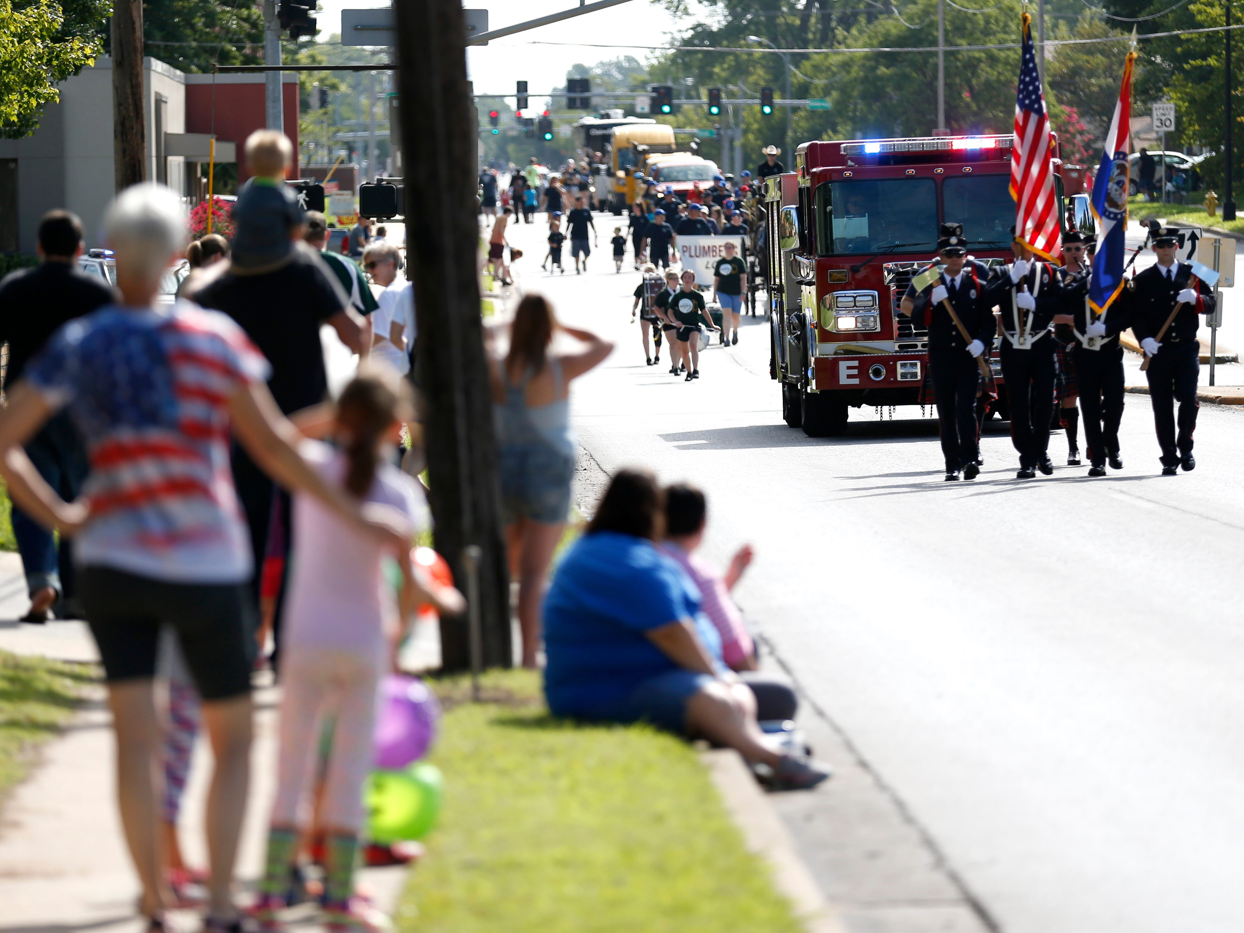 People line the streets as the 2018 Labor Day Parade passes by on Monday, Sept. 3, 2018.