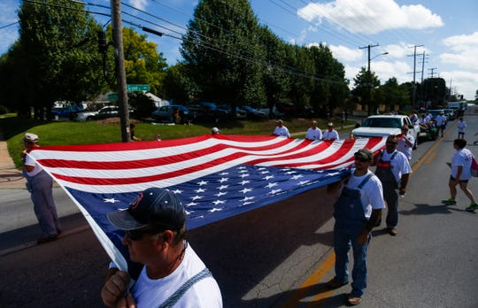 Laborers from the carpenters union carry an American Flag during the 2018 Labor Day Parade on Monday, Sept. 3, 2018.