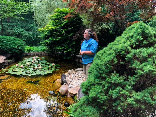 In this June 28, 2018 photo, Jessica Bonilla, the head gardener at Hillwood Estate, Museum and Gardens in Washington, said those in her profession are trying to use fewer chemicals to cultivate their plants.
