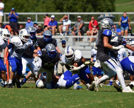 Robert E. Lee's defense tackled Rockbridge County's Johnathan Dunn during the completion of their lightning-delayed game on Monday, Sept. 3, 2018, at Winston Wine Memorial Stadium in Staunton, Va.