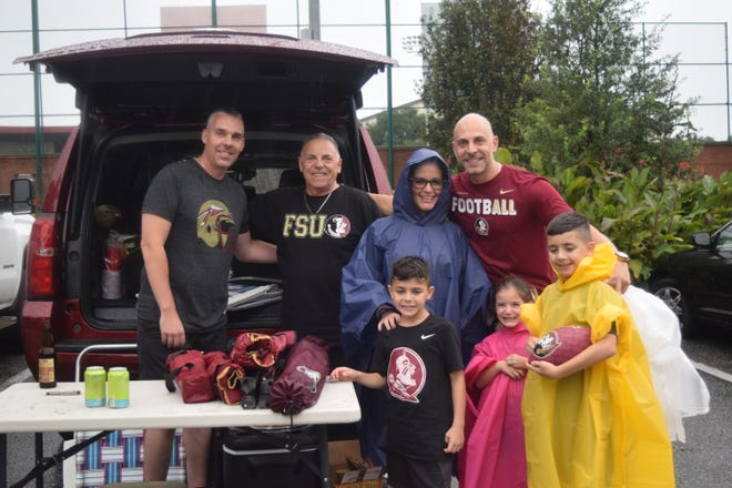 A family tailgates during the Florida State versus Virginia Tech game on Monday.