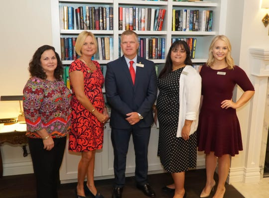 Leslie Warren, left, Jenny Yingling, Robert Barfield, Denise Anderson and Olivia Kirchman with Seacoast Bank.