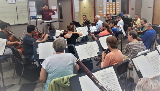 The Vero Beach Chamber Orchestra, conducted by Colbert Page Howell, rehearses for its 11th season.