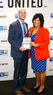 Gene Zweben, of Zweben Law Group, accepts the Volunteer of the Year Award from Carol G. Houwaart-Diez, president/CEO of United Way of Martin County.