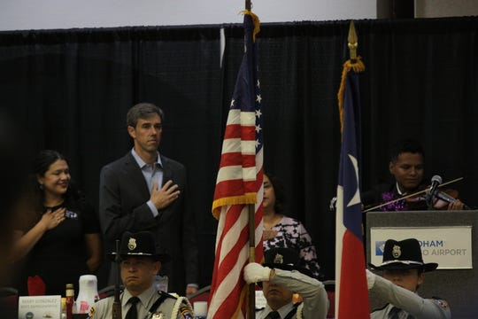 U.S. Rep. Beto O'Rourke stands for the pledge of allegiance during the 44th annual Labor Day Breakfast on Monday in Central El Paso.