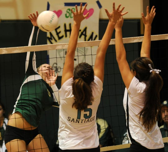 Kirra Drury, left, starred for the St. Bonaventure High volleyball team.