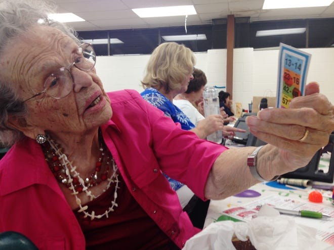 Hilda Corson, age 107, holds up her pull tab during a bingo game presented by the Knights of Columbus Council #5803 in Simi Valley.