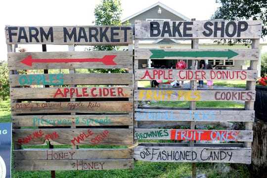 Signs posted for the farm market and bake shop at Wilkens Fruit & Fir Farm in Yorktown Heights Sept. 3, 2018 during the first weekend of apple picking for the season.