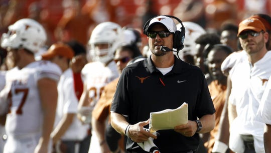 Texas head coach Tom Herman walks on the sideline in the second half of an NCAA college football game against Maryland, Saturday, Sept. 1, 2018, in Landover, Md.  The Longhorns lost 34-29, a second straight loss to Maryland.