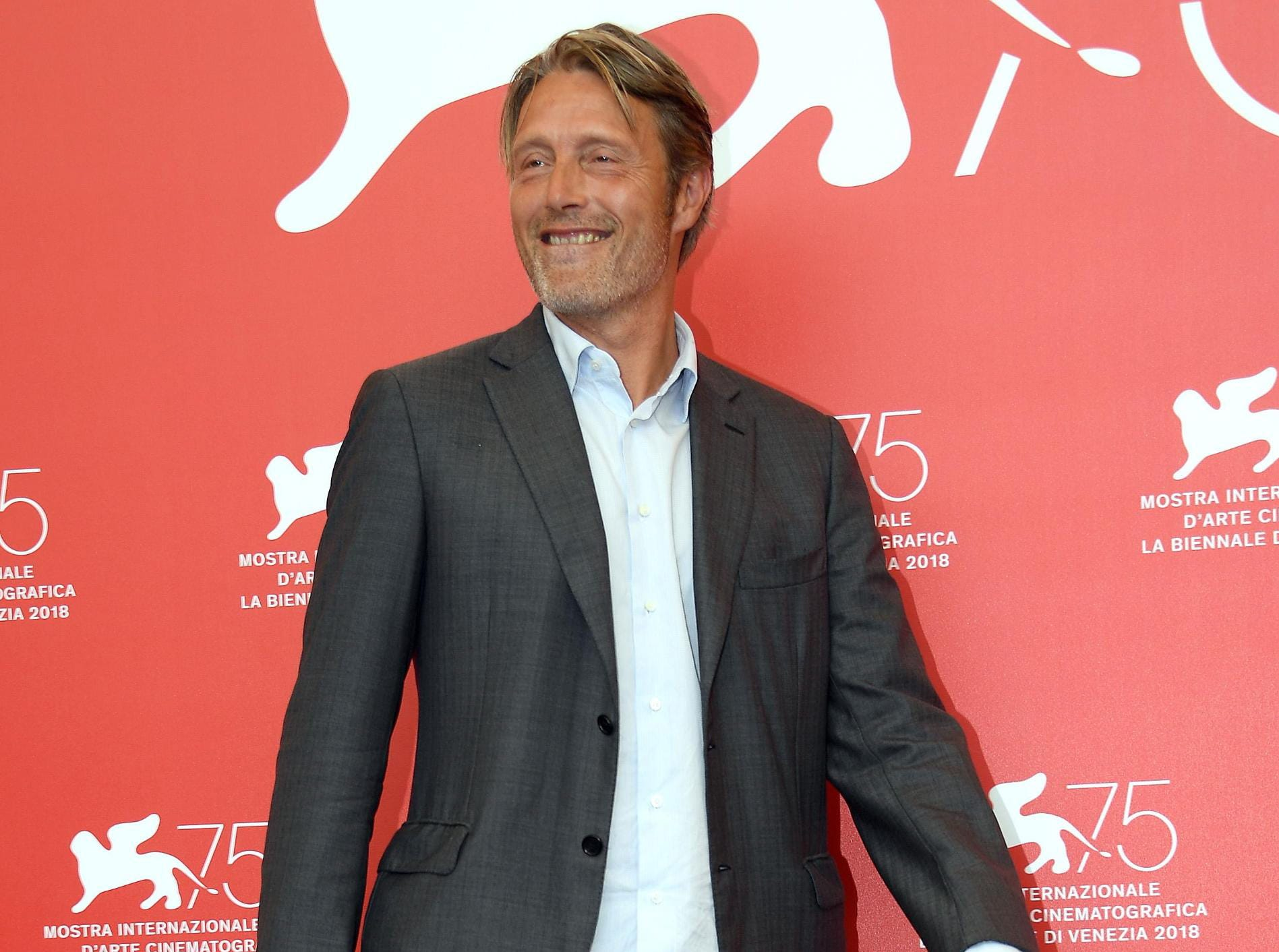 epa06994594 Danish actor Mads Mikkelsen poses during a photocall for 'At Eternitys Gate' at the 75th annual Venice International Film Festival, in Venice, Italy, 03 September 2018. The movie is presented in official competition Venezia 75 at the festival running from 29 August to 08 September 2018.  EPA-EFE/CLAUDIO ONORATI ORG XMIT: VFF100