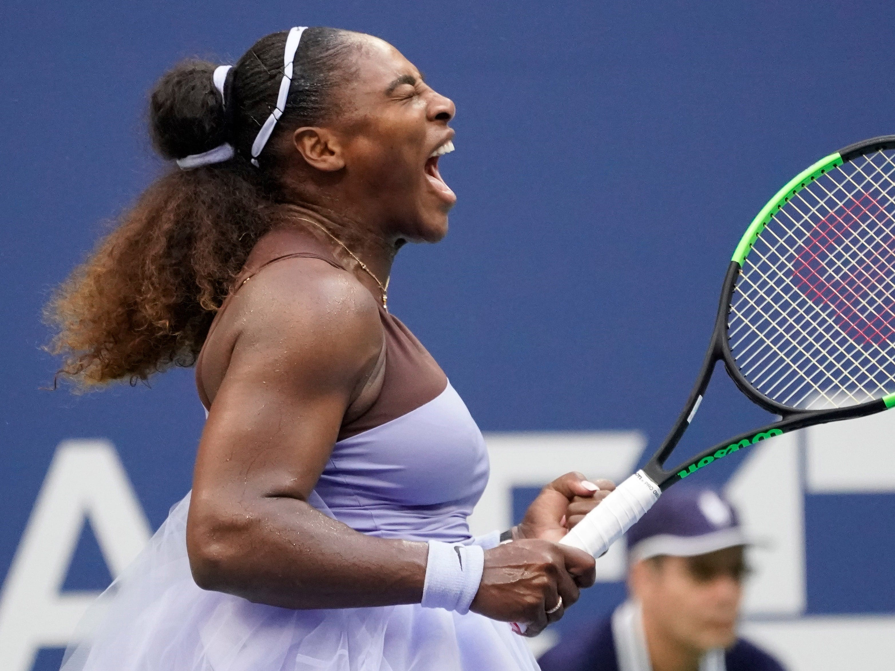 Serena Williams gets fired up for a big point against Kaia Kanepi.