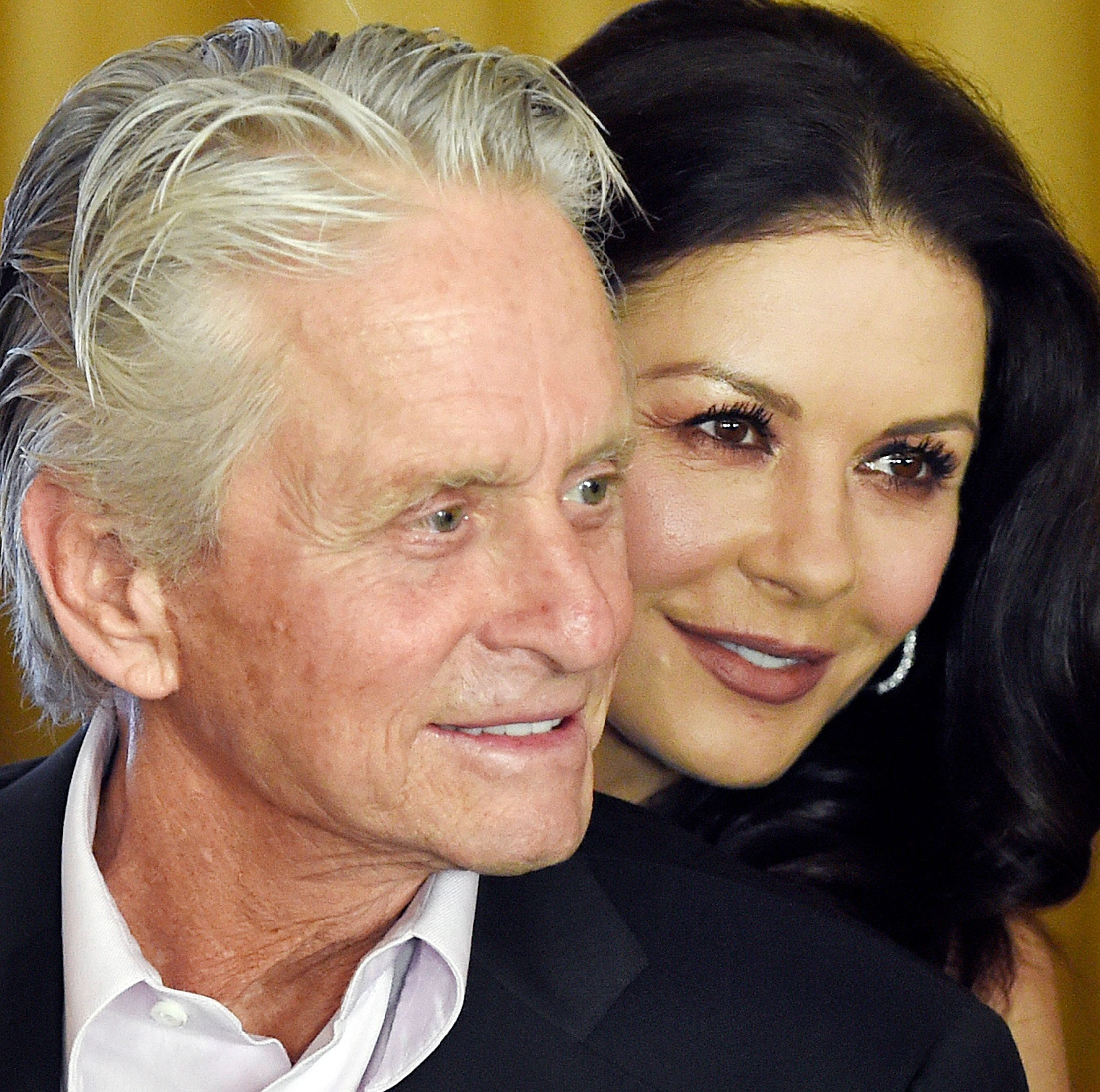 Catherine Zeta Jones and Michael Douglas bid their son an emotional farewell as they moved him into a college dorm in an Instagram video.