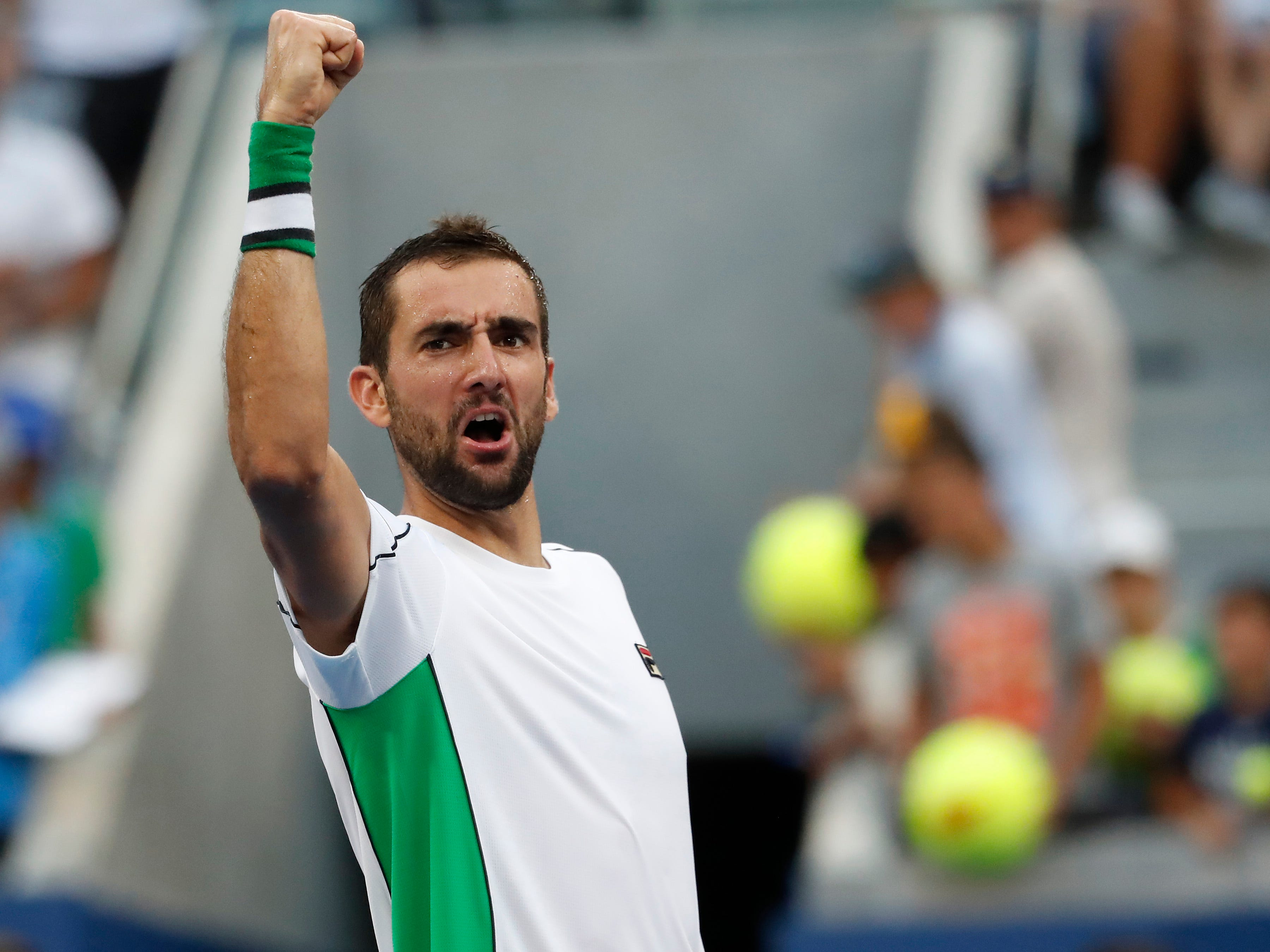 Croatia's Marin Cilic, the No. 7 seed and 2014 US Open champion, salutes the crowd after his fourth-round win against No. 10 seed David Goffin of Belgium.