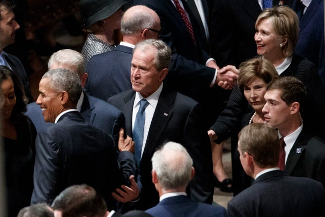 Barack Obama and George W. Bush at a memorial service for Sen. John McCain on Sept. 1, 2018, in the Washington National Cathedral.