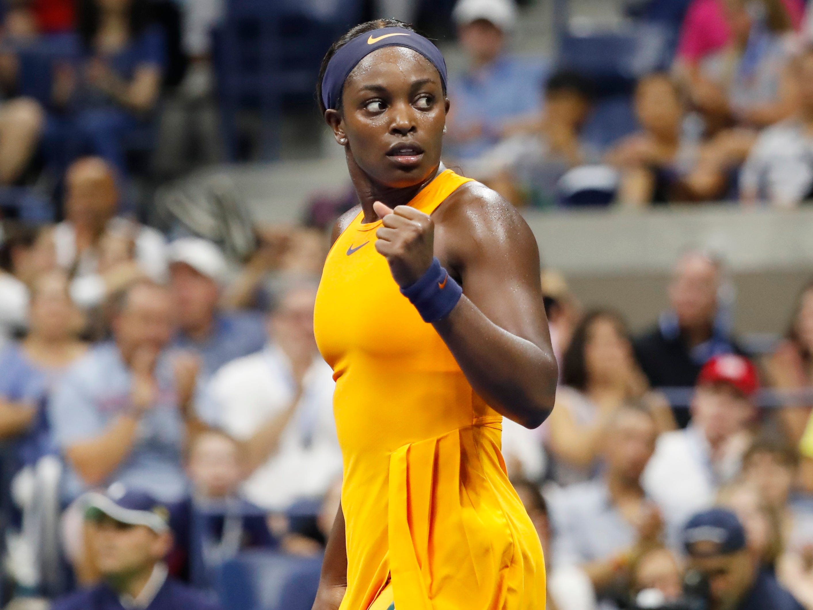 Sloane Stephens celebrates after taking the first set from Elise Mertens.