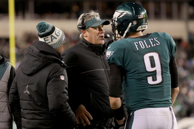 Head coach Doug Pederson of the Philadelphia Eagles talks to Nick Foles #9 on the sidelines against the Atlanta Falcons during the fourth quarter in the NFC Divisional Playoff game at Lincoln Financial Field on January 13, 2018 in Philadelphia, Pennsylvania.