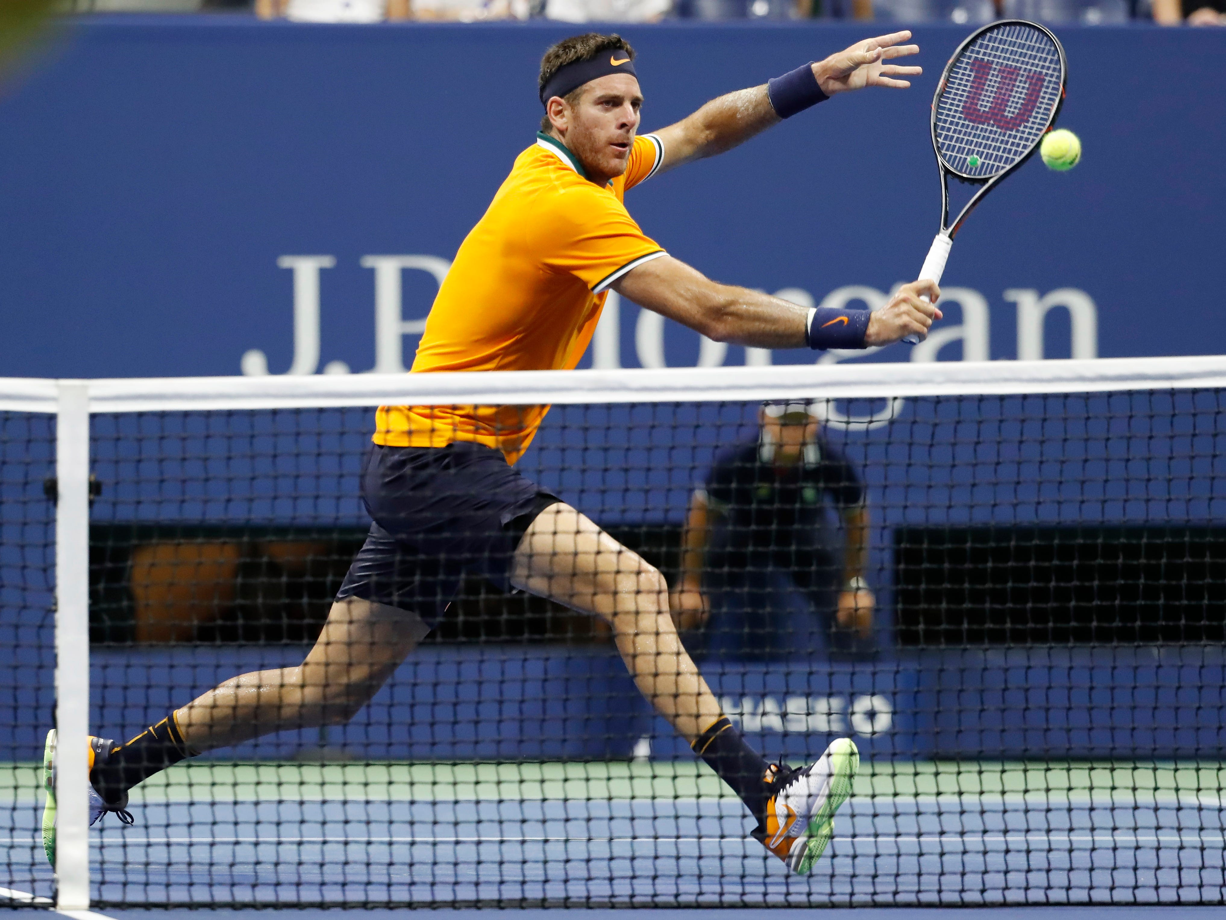 Juan Martin del Potro runs down a backhand return against Borna Coric.