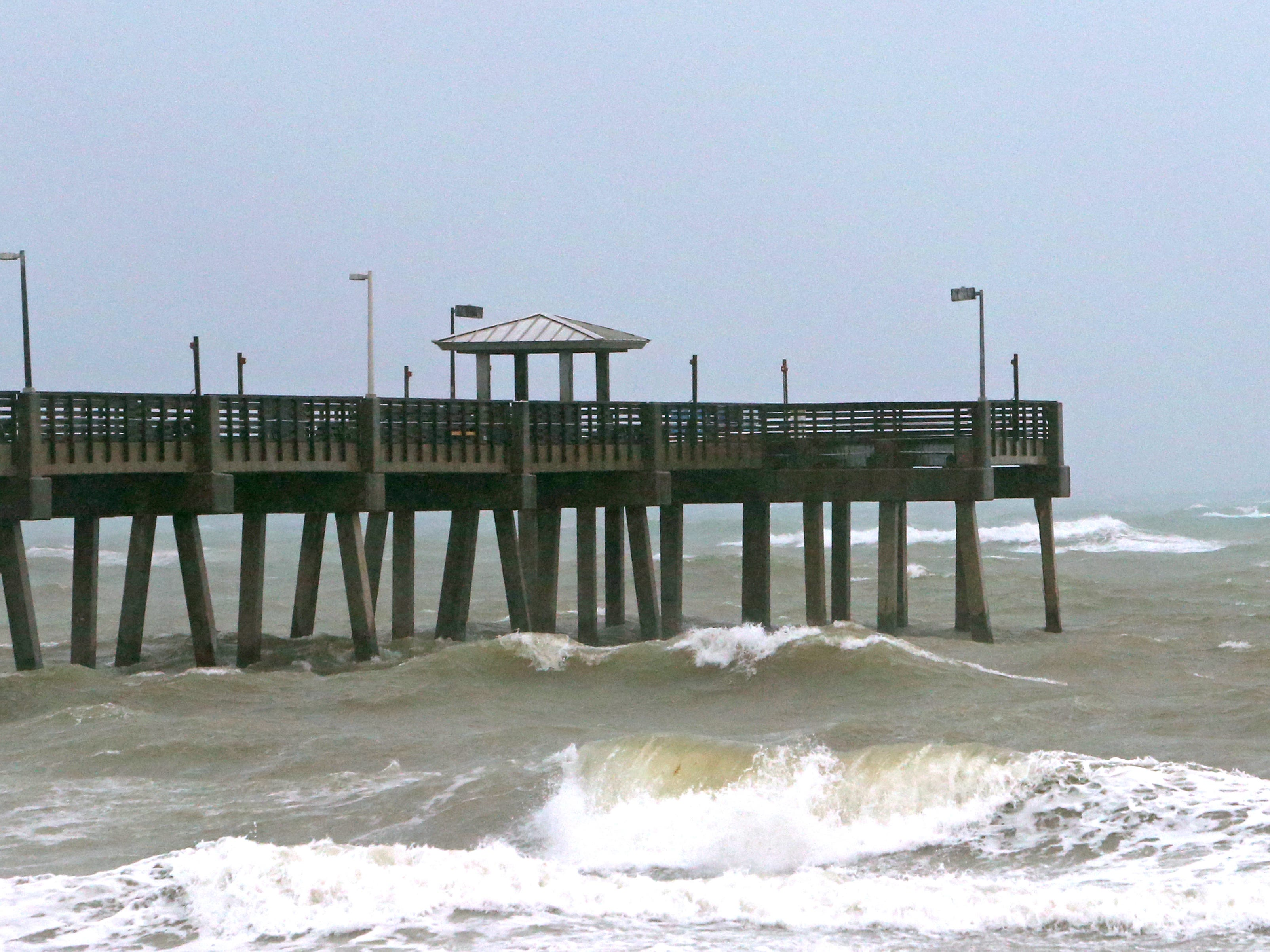 A view of the waves at the Dania Beach, Fla., Pier as Tropical Storm Gordon passes by South Florida with wind gusts and heavy rainfall for the Labor Day holiday on Sept. 3, 2018.