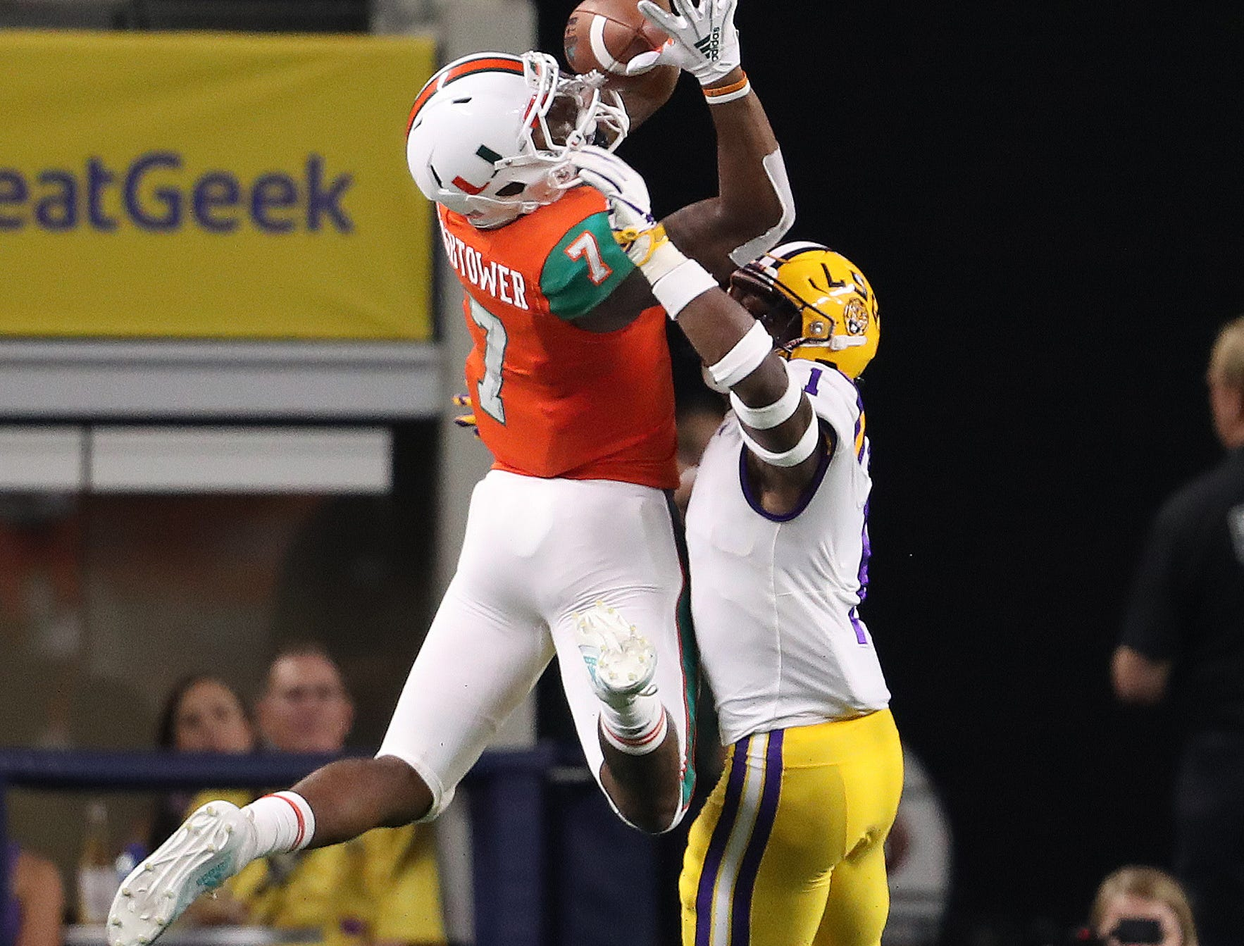 Miami Hurricanes receiver Brian Hightower (7) makes a fourth-quarter touchdown catch against LSU Tigers cornerback Kelvin Joseph (1) at AT&T Stadium.