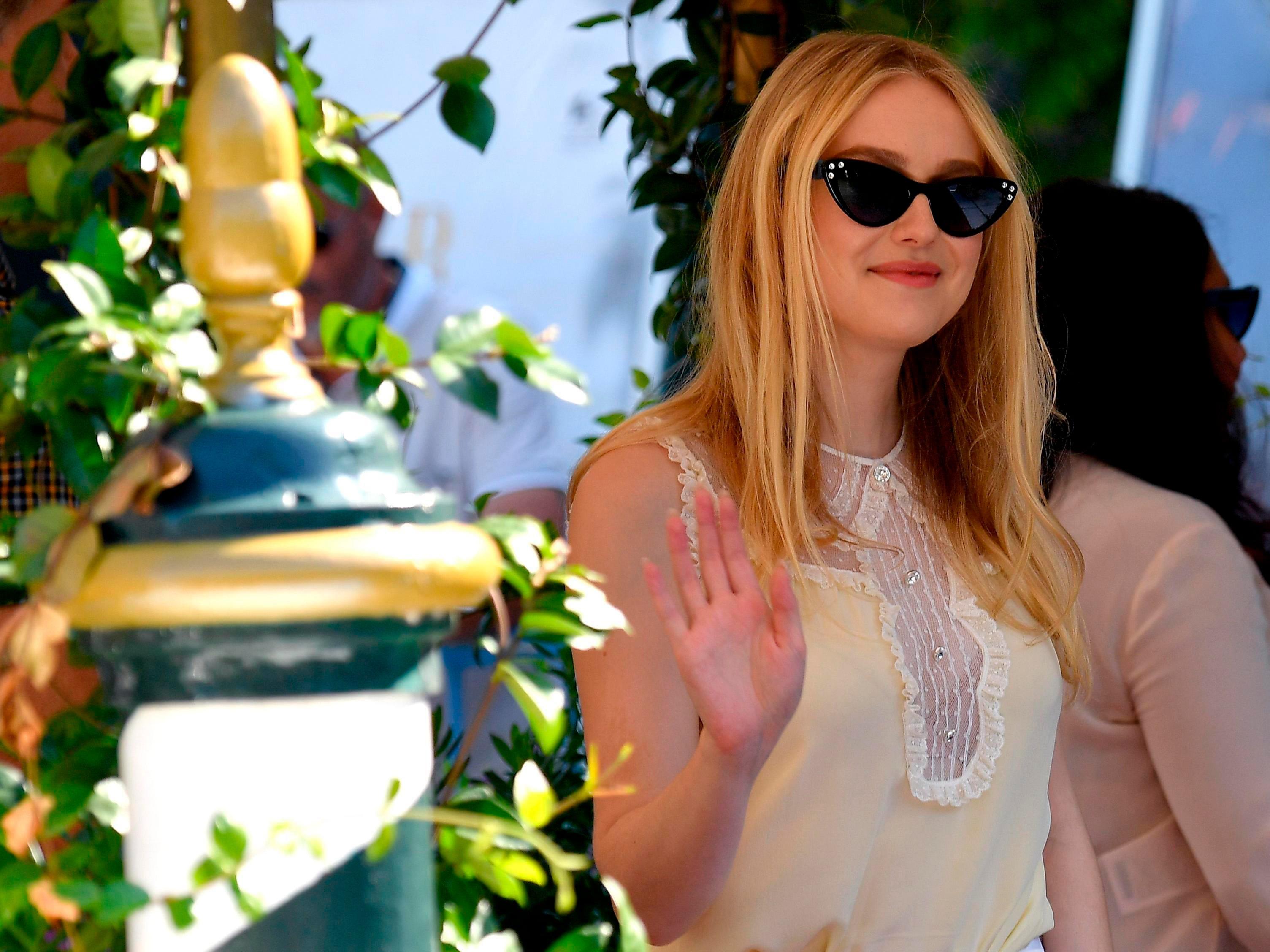 Actress Dakota Fanning arrives at the Lido Beach for the 75th annual Venice International Film Festival, in Venice, Italy, Monday, Sept. 3, 2018. (Ettore Ferrari/ANSA via AP) ORG XMIT: VEN808