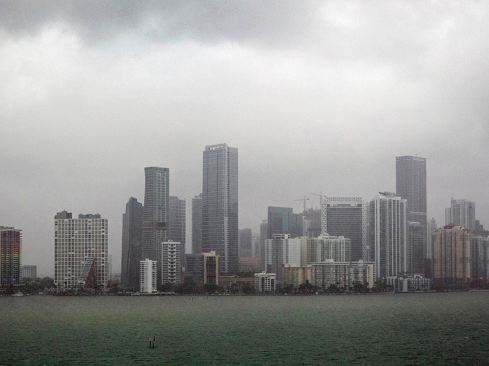 Rain falls on the Miami skyline, Monday, Sept. 3, 2018. Tropical Storm Gordon lashed South Florida with heavy rains and high winds on Monday, forcing holiday beachgoers to drier ground. Weather forecasters said the storm could strengthen to near-hurricane force by the time it hits the  Gulf Coast.