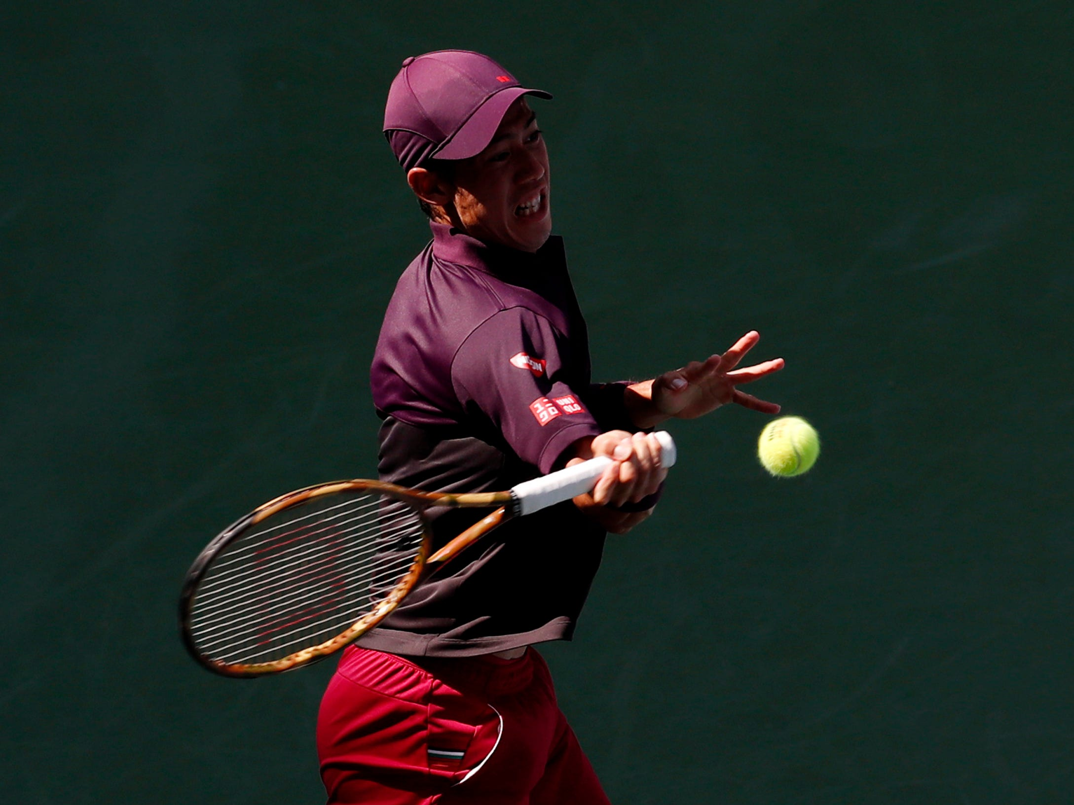 Kei Nishikori of Japan hits to Philipp Kohlschreiber of Germany.