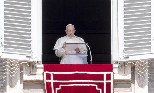 Pope Francis leads his Angelus prayer from the window of his office overlooking Saint Peter's Square at the Vatican on Sunday, Sept. 2.
