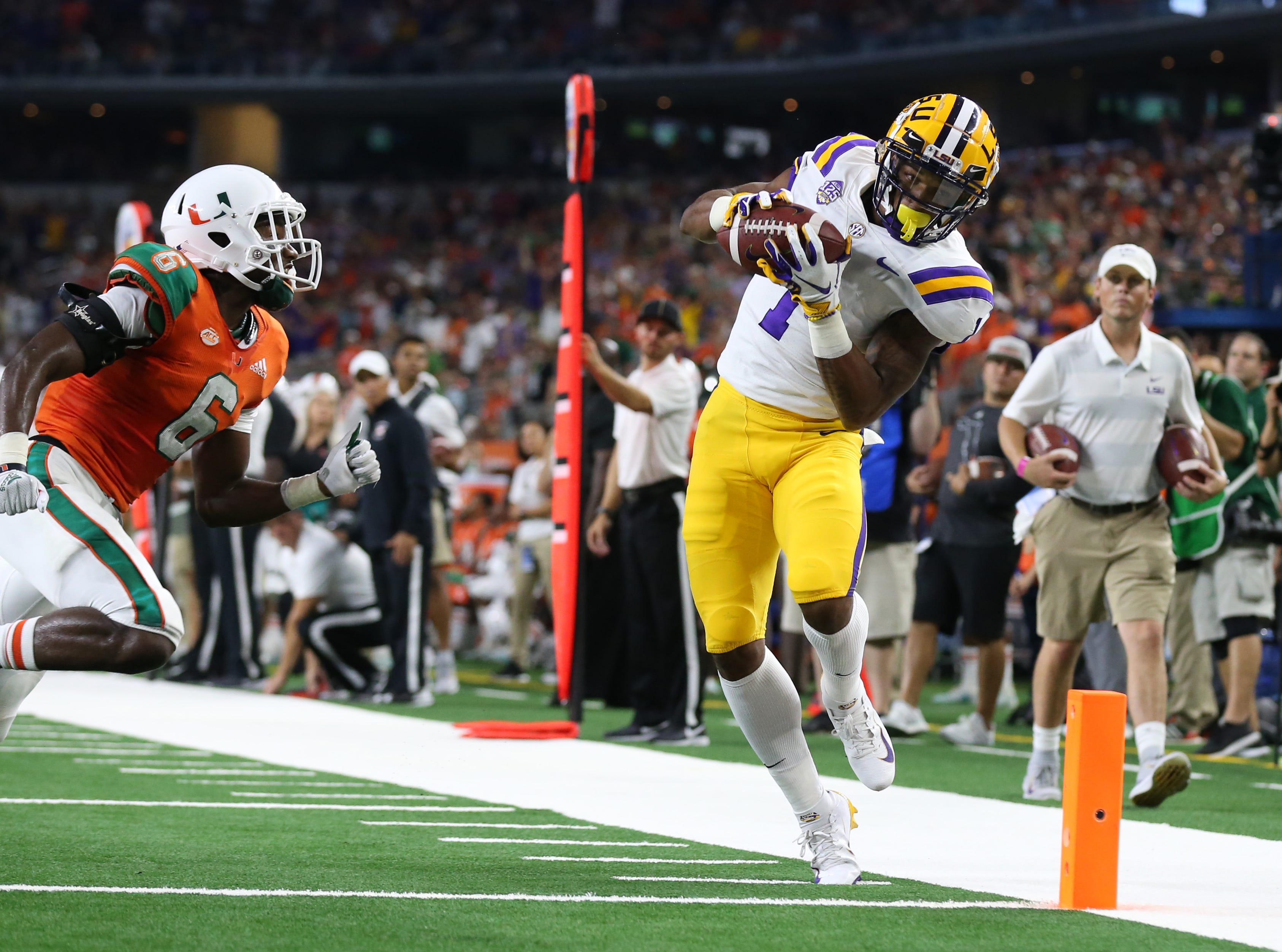 LSU Tigers receiver Ja'Marr Chase (1) makes a catch at the 1-yard line in the second quarter against Miami Hurricanes cornerback Jhavonte Dean (6) at AT&T Stadium.