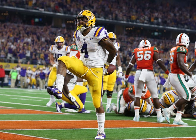 LSU Tigers running back Nick Brossette (4) celebrates scoring a touchdown in the second quarter against the Miami Hurricanes at AT&T Stadium.
