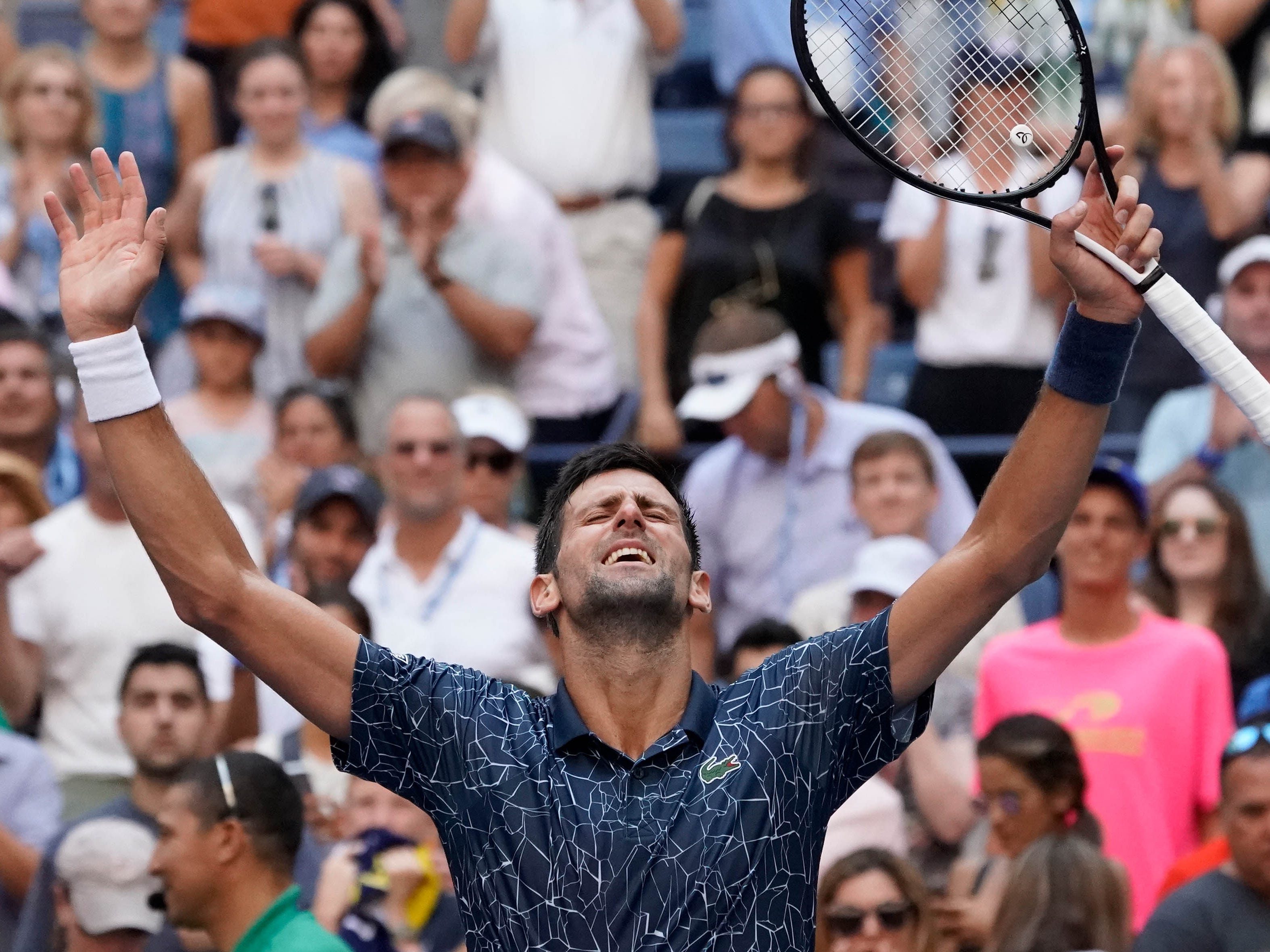 Novak Djokovic of Serbia exults after beating Joao Sousa of Portugal 6-3, 6-4, 6-3.
