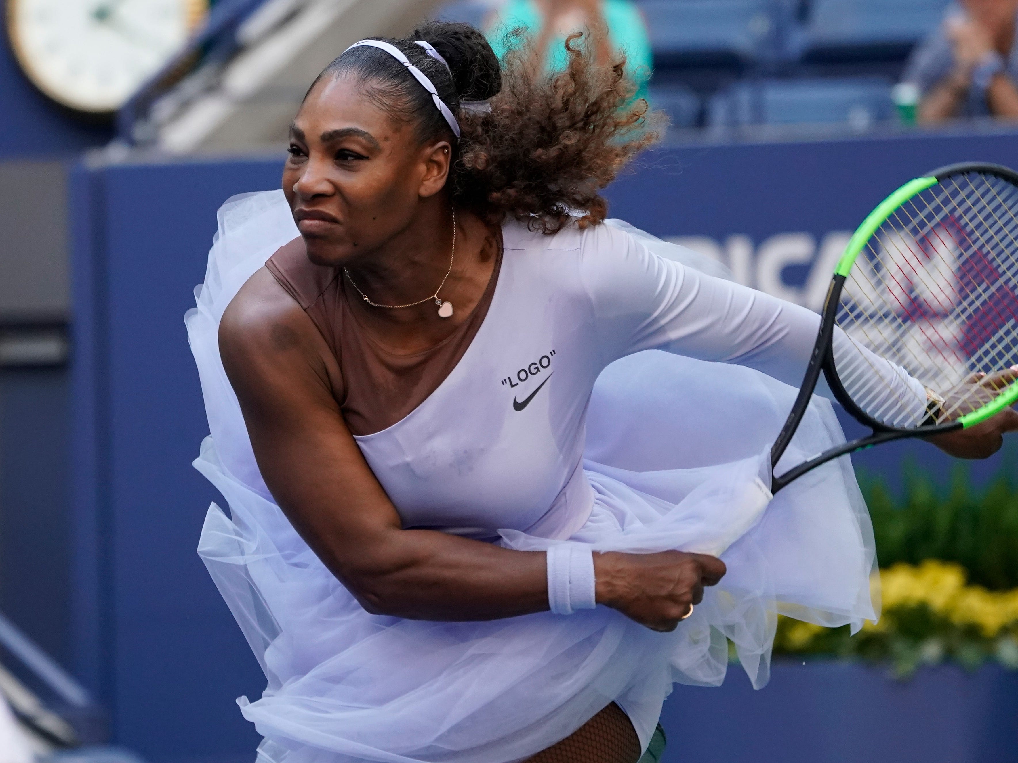 Serena Williams follows through on a serve against Kaia Kanepi.