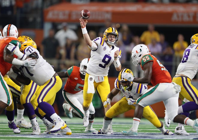 LSU Tigers quarterback Joe Burrow throws in the pocket against the Miami Hurricanes at AT&T Stadium.