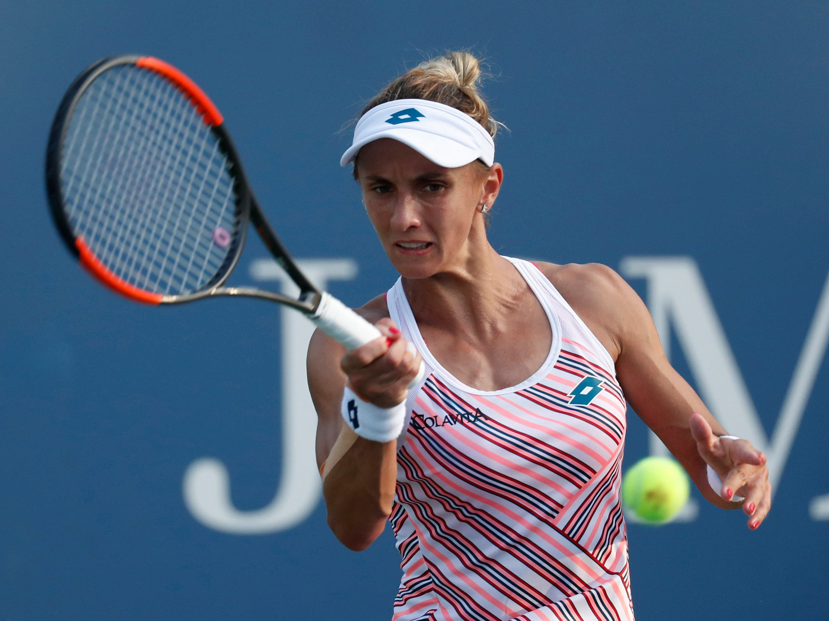Lesia Tsurenko of Ukraine plays a forehand against Marketa Vondrousova of the Czech Republic during her 6-7 (7-3). 7-5, 6-2 fourth-round win.