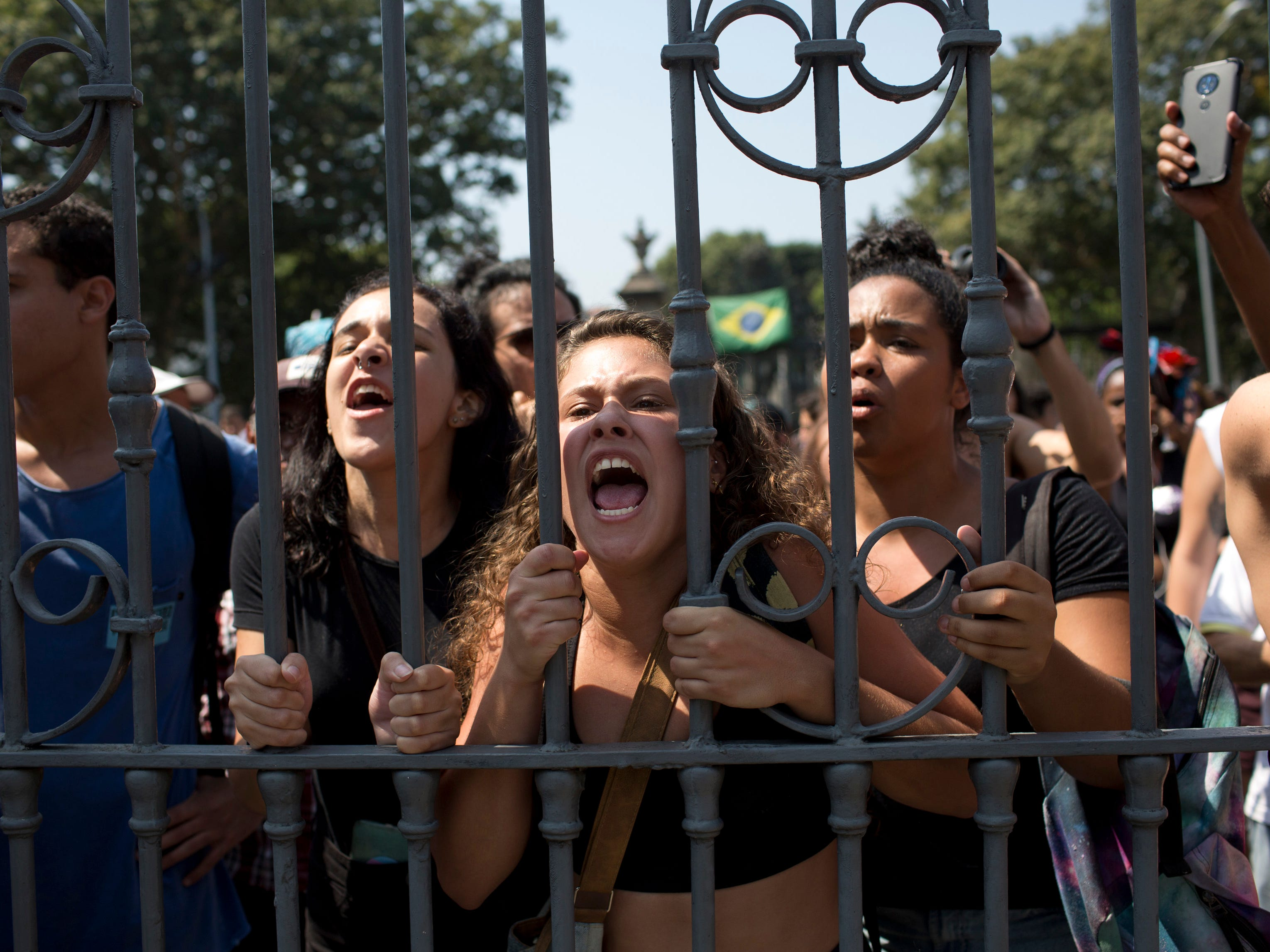 Students and National Museum employees protest outside the institution after it was gutted by an overnight fire in Rio de Janeiro, Brazil, Sept. 3, 2018. Recriminations flew over who was responsible for the loss of at least part of Latin America's largest archive of historical artifacts, objects and documents.