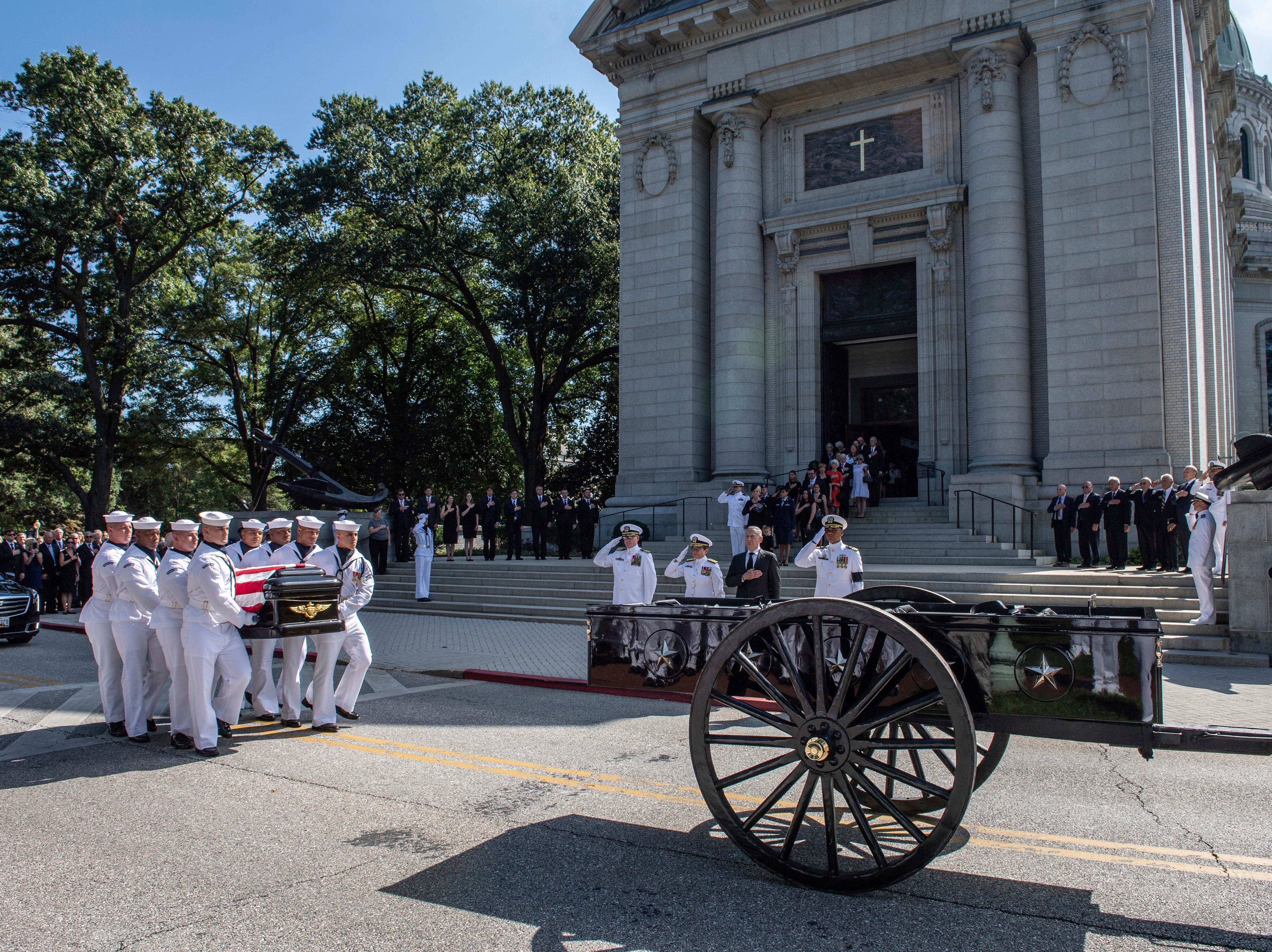 In this image provided by the U.S. Navy, Navy Body Bearers place the casket of Sen. John McCain onto a horse-drawn caisson after his funeral service at the United States Naval Academy Chapel, Sunday, Sept. 2, 2018, in Annapolis, Md.