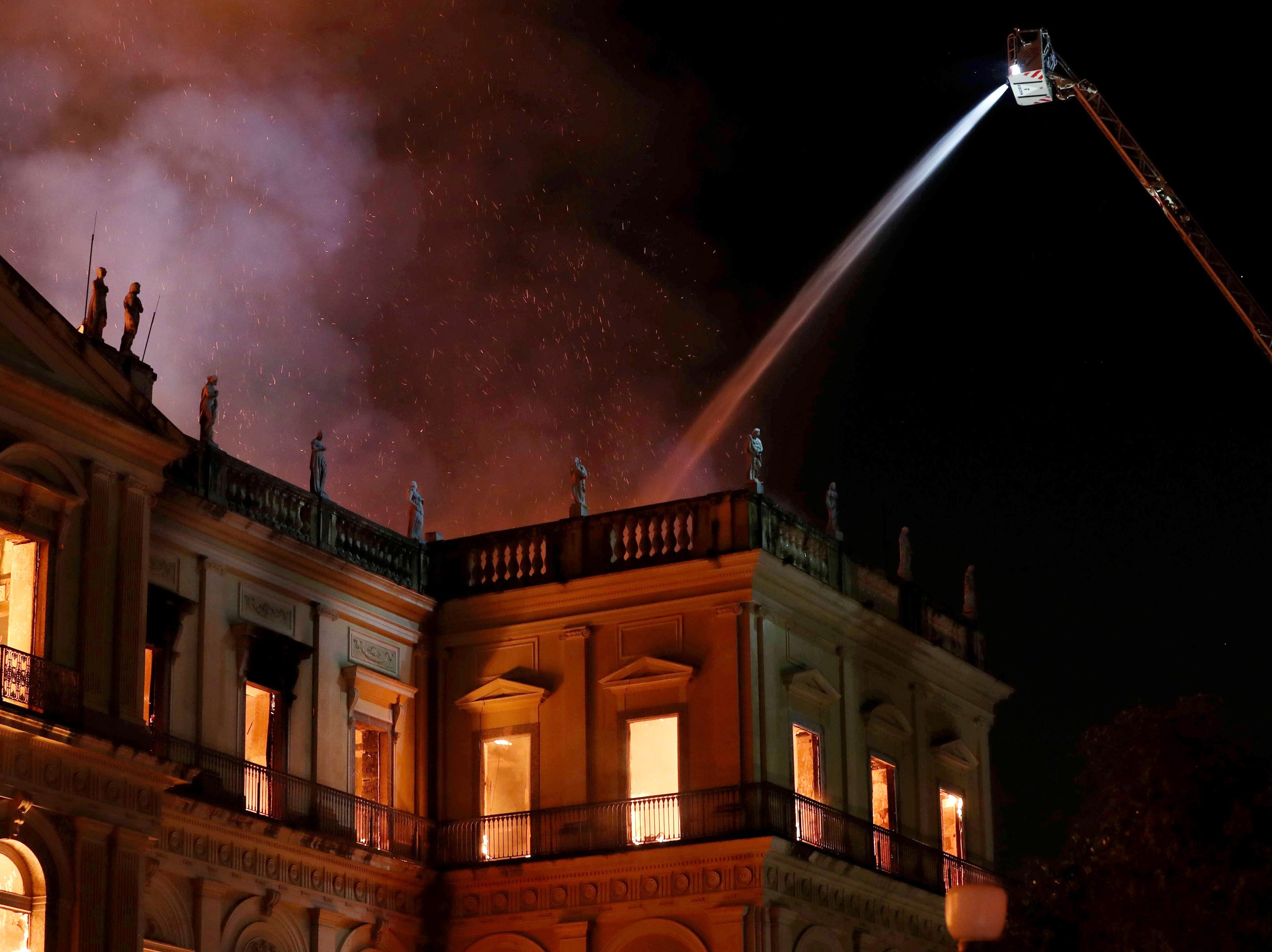 epaselect epa06993681 Firefighters work to contain a fire at the National Museum of Rio de Janeiro in Rio de Janeiro, Brazil, 02 September 2018. The museum houses some 20 million pieces that date back to the Brazilian imperial era. Authorities have said the cause of the fire is still unknown. No injuries have been reported.