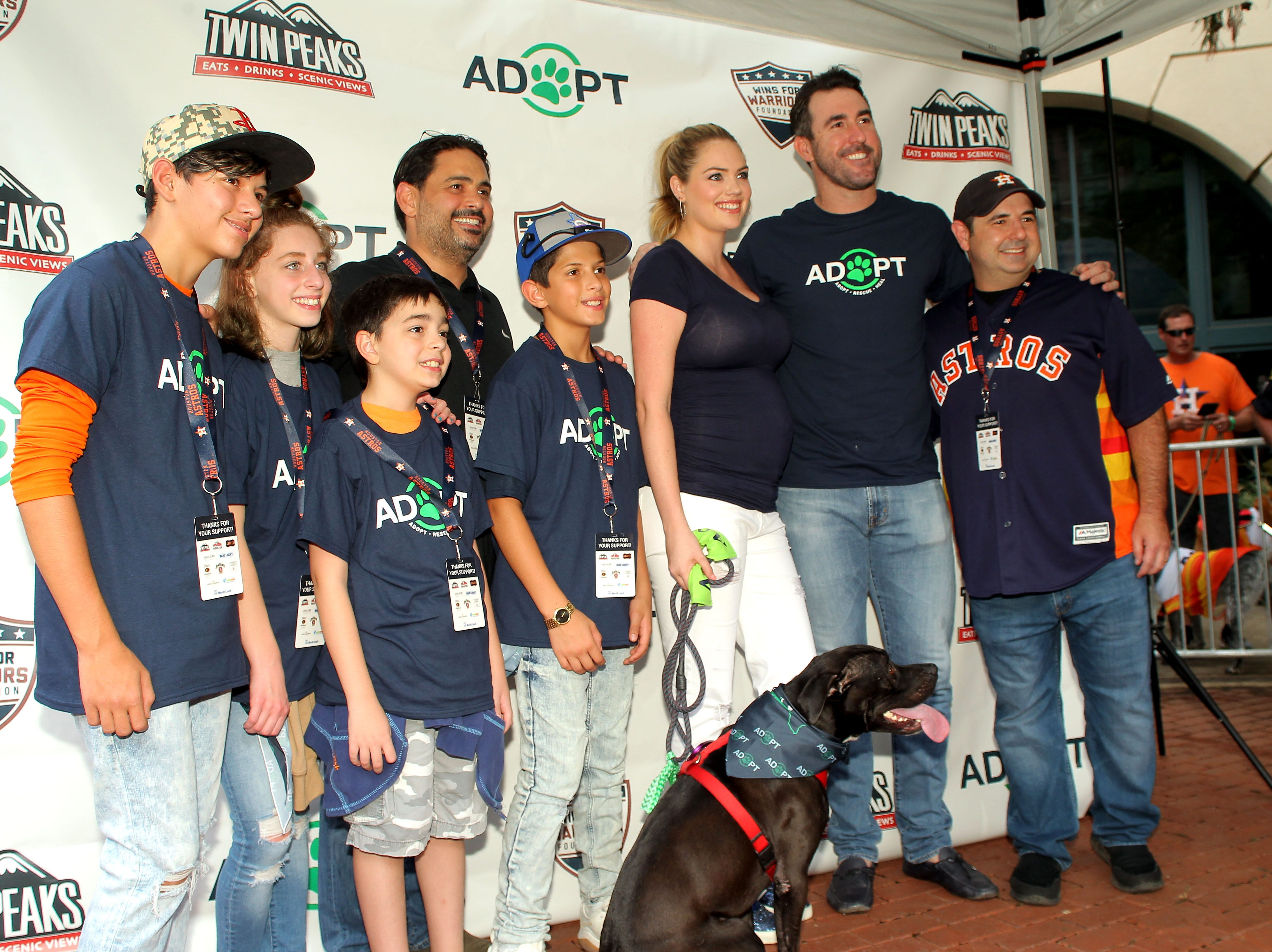 Houston Astros starting pitcher Justin Verlander and wife Kate Upton pose for photos during the Astros' Dog Day.