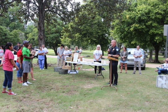 Chief Jerrod King speaks to a crowd in Alexandria City Park about the opioid epidemic. King sees it as one of the challenges facing his the Alexandria Police Department and beyond.