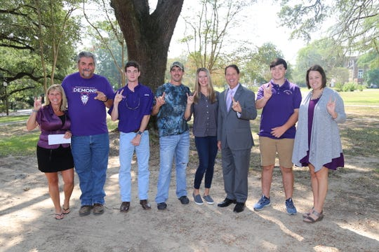 From left are Jill Bankston, development officer at NSU; Juddy Hamous, fishing team sponsor; Jackson McGee of Shreveport; Burt and Shelley Poche; Chris Maggio, president of NSU; Gage Ulrich of Pineville; and Brittney McNeely, development officer at NSU. The Poche family presented Ulrich and McGee with $5,000 scholarships in memory of of Dylan Kyle Poche.