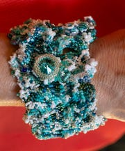 """A bracelet that is three dimensional to remind people of the surface of waves. """"Beaded by the Beach,"""" a four-year-old Manasquan-based beading business run by professional beader Susan Pelligra. Photos taken in her home studio in Manasquan on September 4, 2018."""