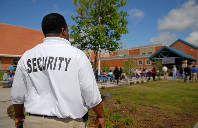 A security guard at a public junior high school.