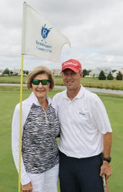Ed Walls with Rosemary Bennett Sunday,  during his 108-hole golf marathon.
