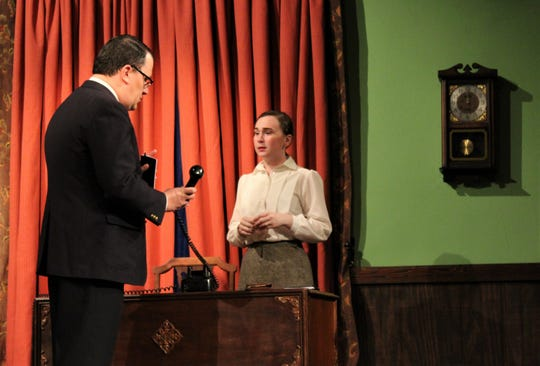 """An investigator from the local police department (Adam Singleton) asks Margot Wendice why she answered the phone from her side of a desk rather than where he is standing in this rehearsal scene from Abilene Community Theatre's """"Dial M For Murder."""""""