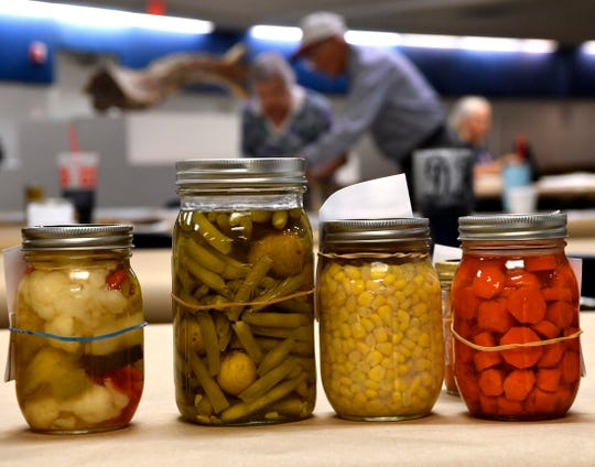 Canned food entries are lined-up in the Round Building at the Taylor County Expo Center Tuesday Sept. 4, 2018, as contestants bring in more. The West Texas Fair & Rodeo begins later this week.