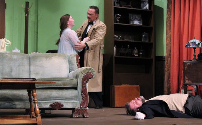 """Tony Wendice (Aaron Schutter) comforts his wife Margot (CC Goad) after returning home to find the body of an intruder (Jed Martin) in their home in this rehearsal scene from """"Dial M For Murder,"""" which continues this weekend at Abilene Community Theatre."""